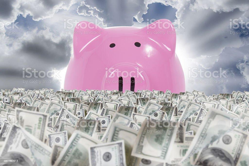 Piggy Bank Shining Behind Banknote Farm stock photo