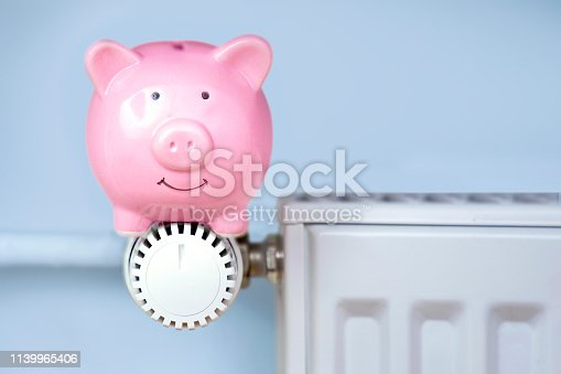 Piggy bank sitting on the heater / thermostat