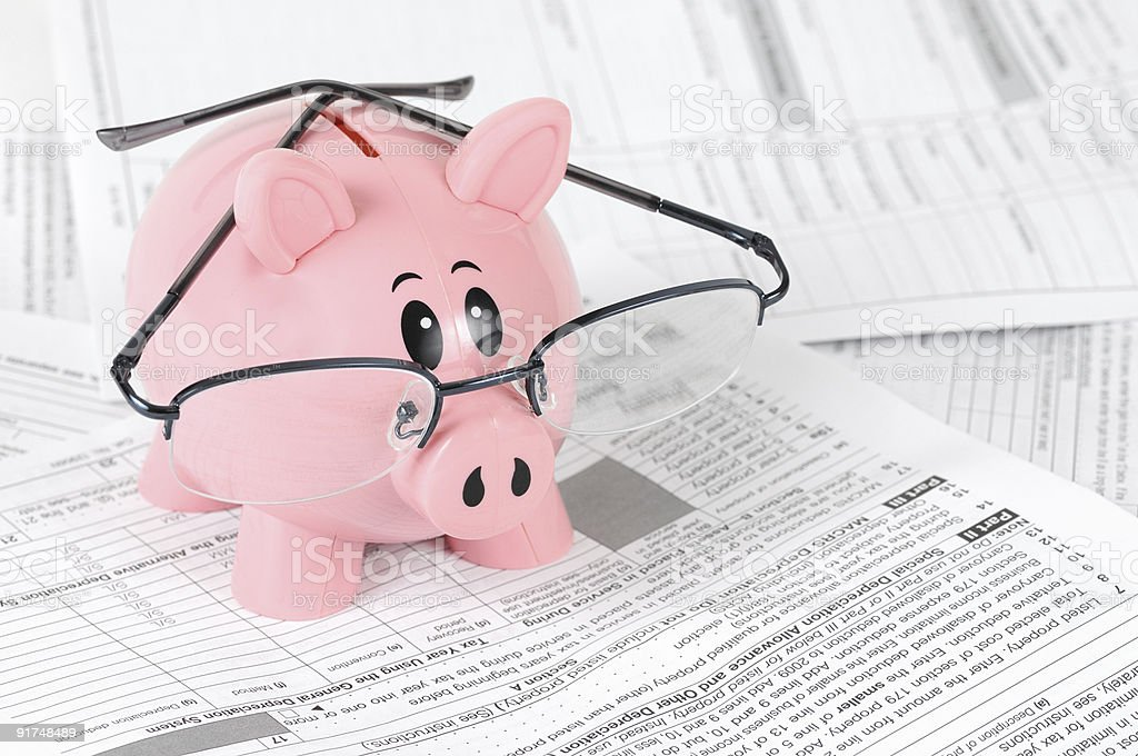 Piggy Bank Studies Tax Forms stock photo