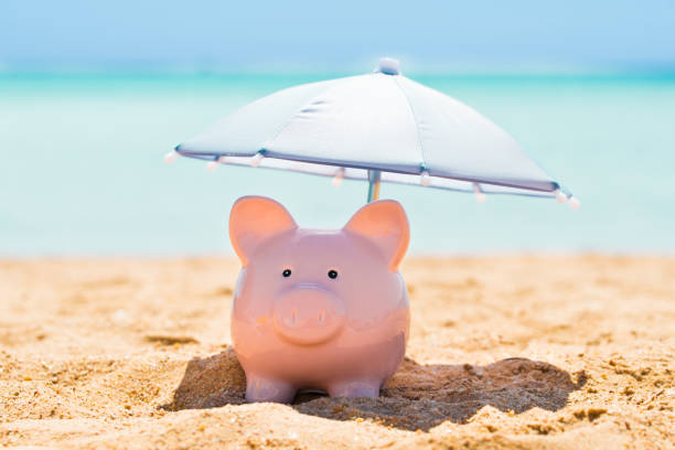 Piggy Bank Under The Parasol At Beach Pink Piggy Bank Under The Small Parasol During Summer At Beach 40 kilometre stock pictures, royalty-free photos & images