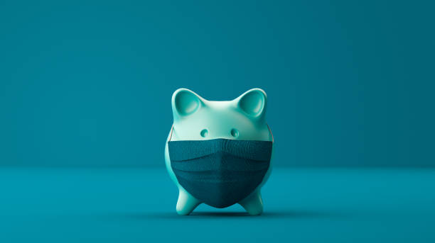Piggy Bank Wearing A Surgical Mask Piggy Bank Wearing A Surgical Mask over blue background. emergency sign stock pictures, royalty-free photos & images