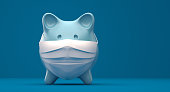 Piggy Bank Wearing A Surgical Mask over blue background.