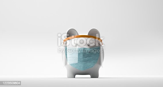 Peeking Piggy Bank Wearing A Surgical Mask over blue background.