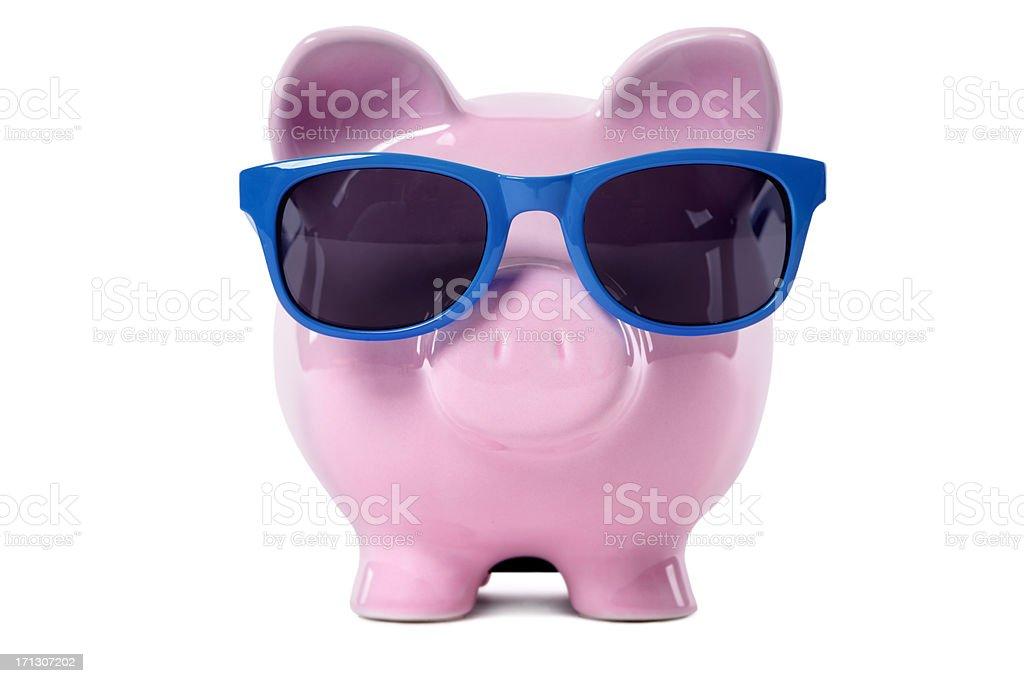 Piggy Bank wearing blue sunglasses royalty-free stock photo