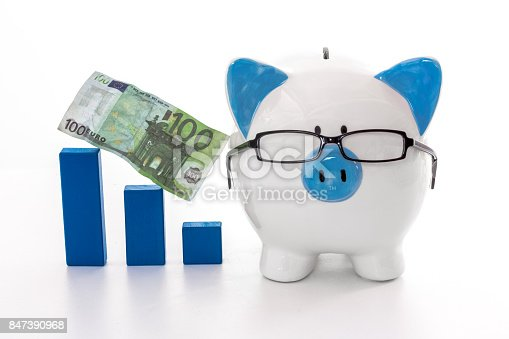 istock Piggy bank wearing glasses with blue graph model and hundred euro note 847390968