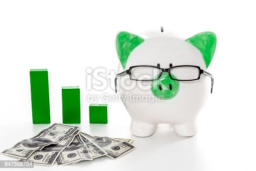 istock Piggy bank wearing glasses with dollars and green graph model 847368754