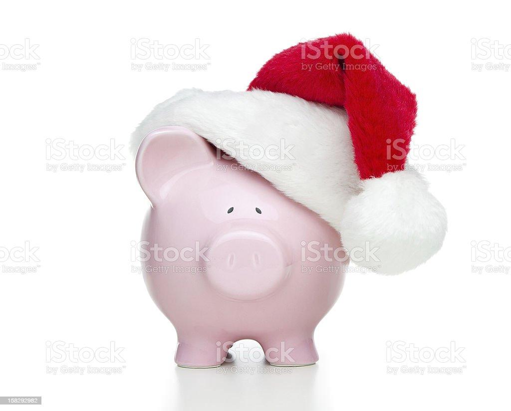 Piggy bank wearing Santa's hat stock photo