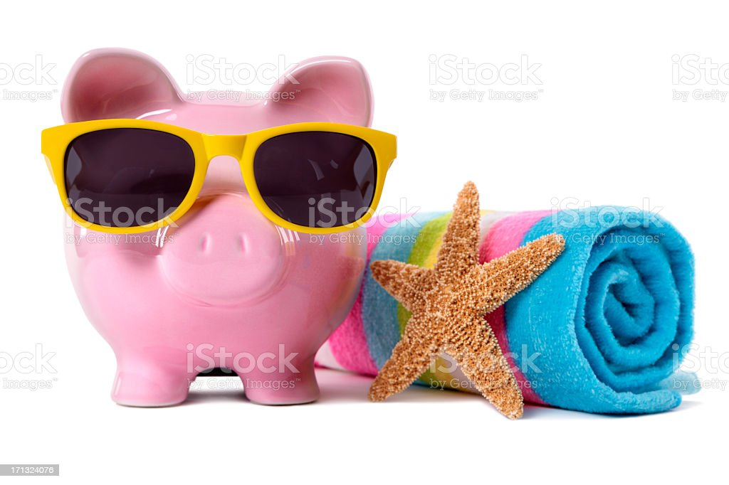 Piggy bank wearing sunglasses on beach vacation royalty-free stock photo