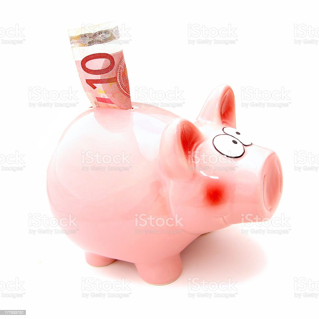 Piggy bank with 10 denomination note stock photo