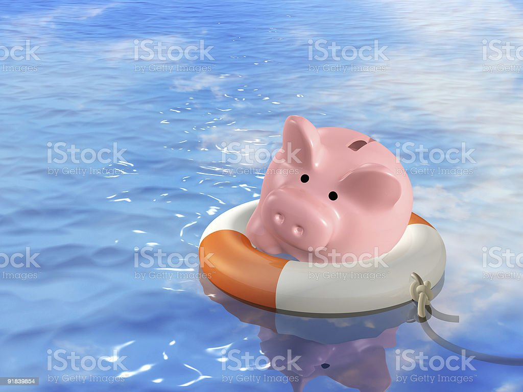 Piggy bank with a life ring floating in the water stock photo