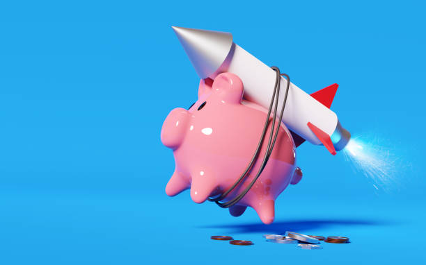 Piggy Bank With A Rocket Strapped To Its Back stock photo