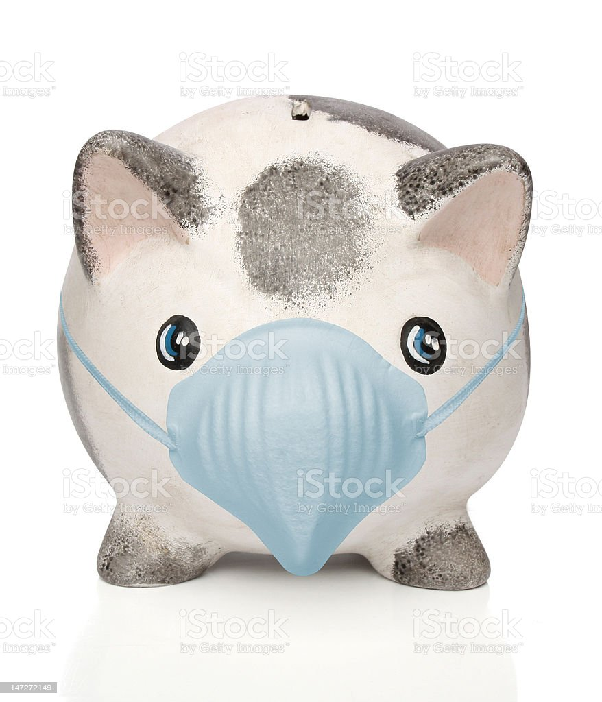 Piggy bank with a surgical mask stock photo