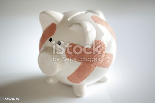 istock Piggy bank with band aids 138028797