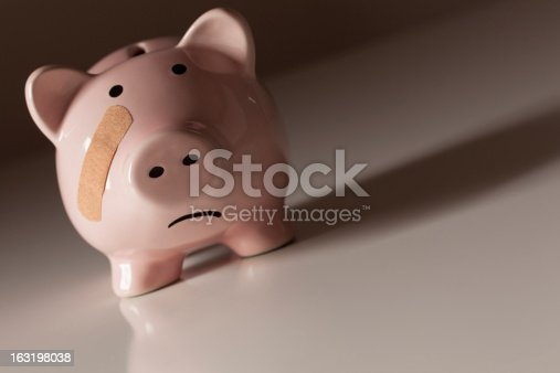 istock Piggy Bank with Bandage on Face 163198038
