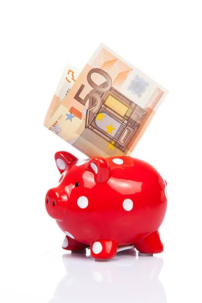 Sparschwein mit Banknote. – Foto