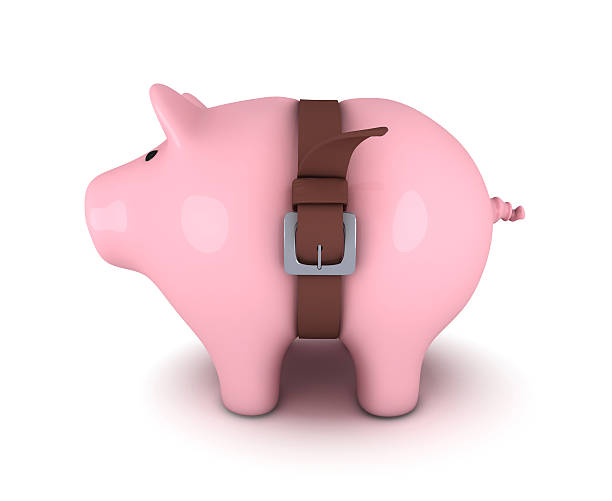 Piggy bank with belt tighten Piggy bank with belt tighten tighten stock pictures, royalty-free photos & images
