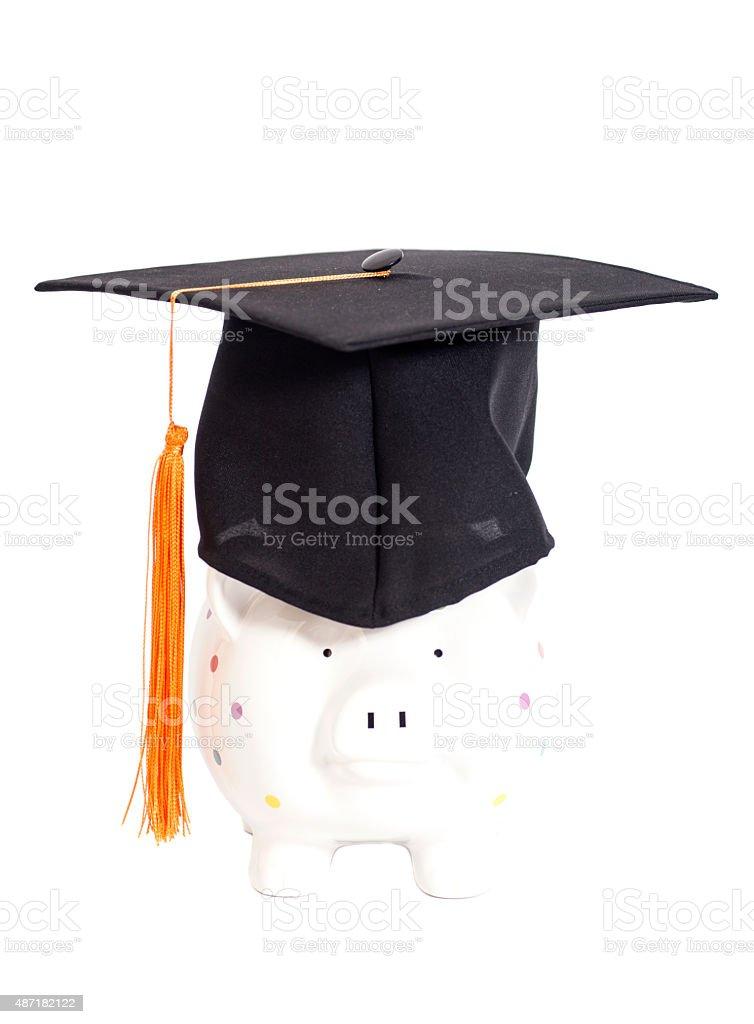 Salvadanaio a porcellino nero con cappello di laurea foto stock royalty-free b6bc563949ef
