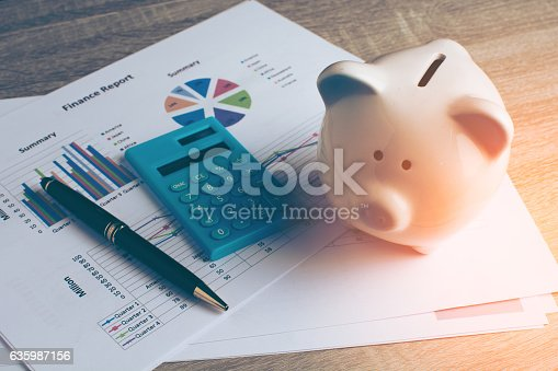 istock Piggy bank with business stuff. 635987156