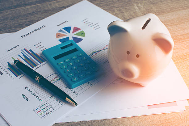 Piggy bank with business stuff. stock photo