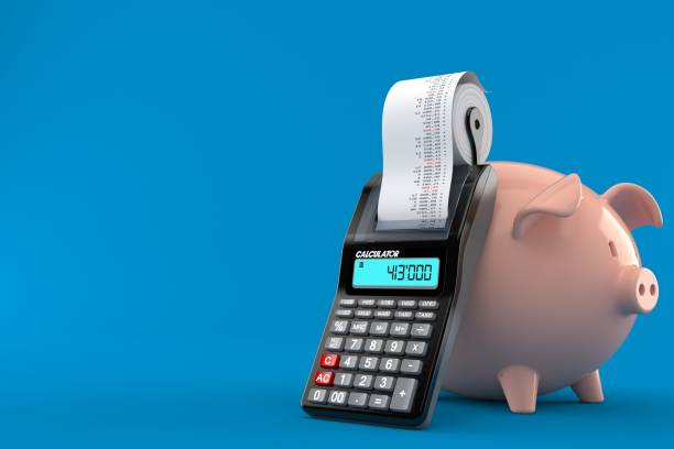 Piggy bank with calculator - foto stock