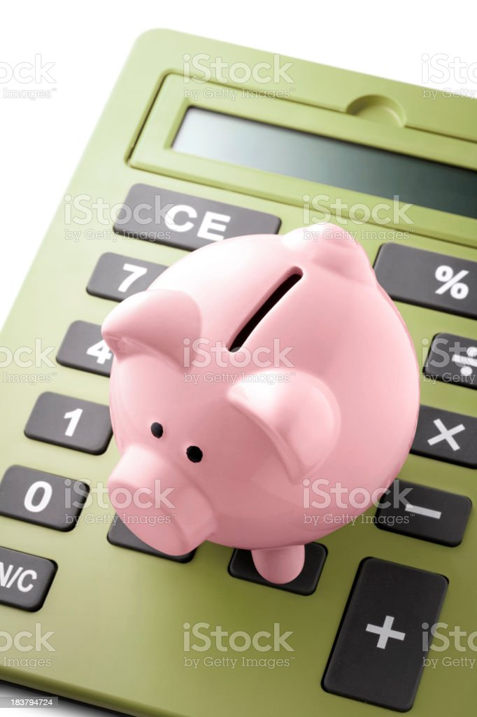 Piggy bank with calculator royalty-free stock photo