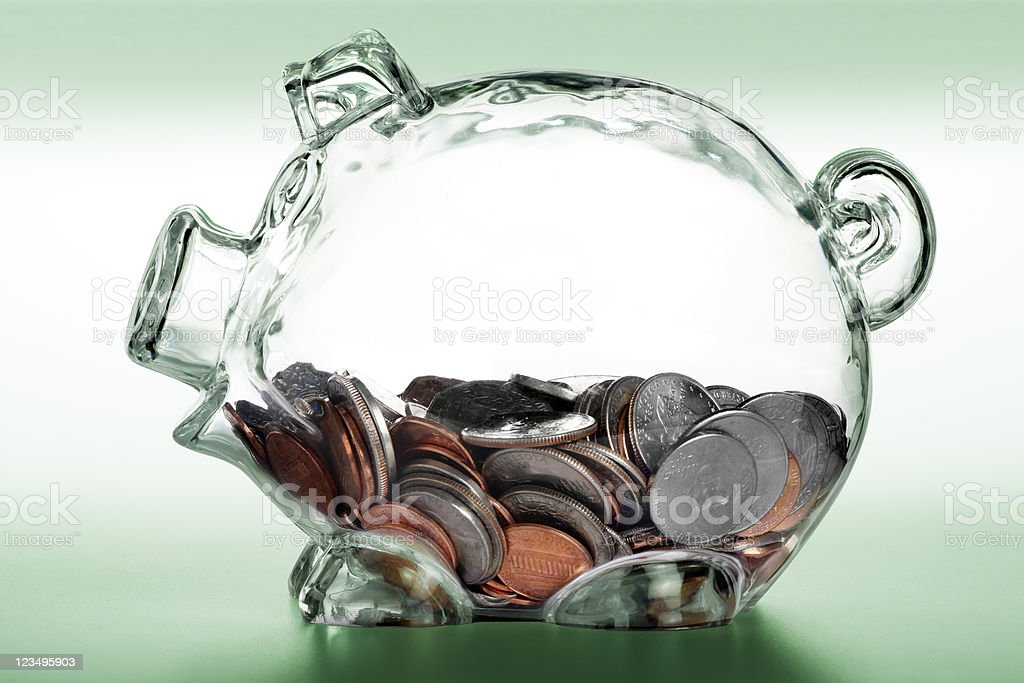 piggy bank with change inside royalty-free stock photo