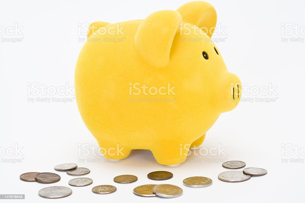 Piggy bank with change stock photo