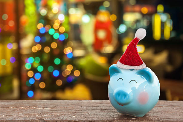 piggy bank with Christmas decoration stock photo