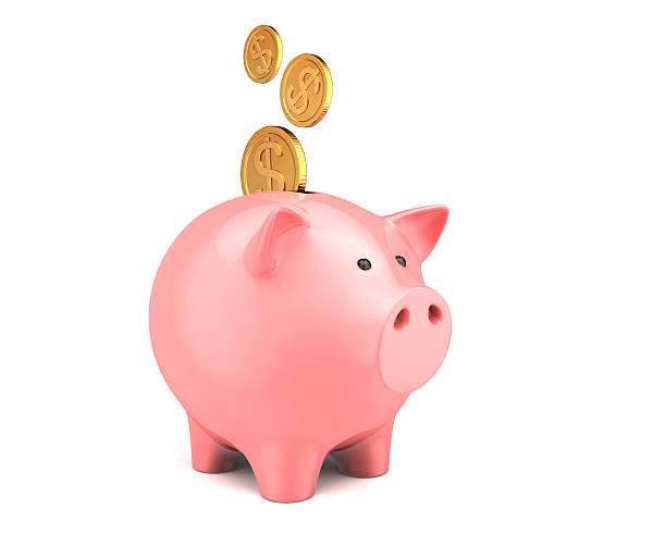 Piggy bank, with coins falling into slot stock photo