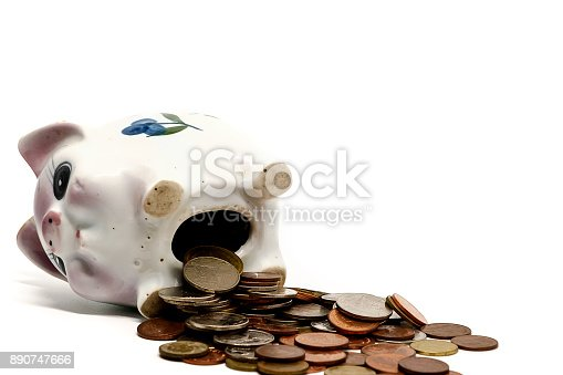 istock Piggy bank with coins on white background for saving money concept 890747666