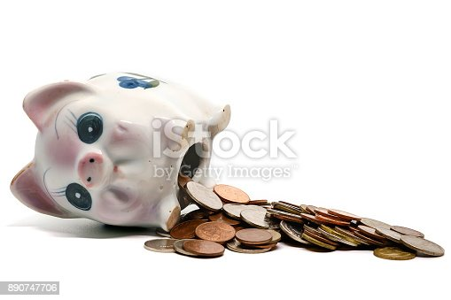 istock Piggy bank with coins on white background for saving money concept 890747706