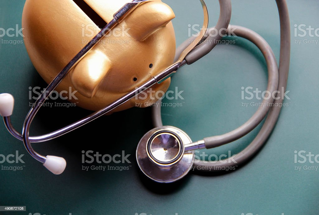 Piggy bank with Doctor's stethoscope stock photo
