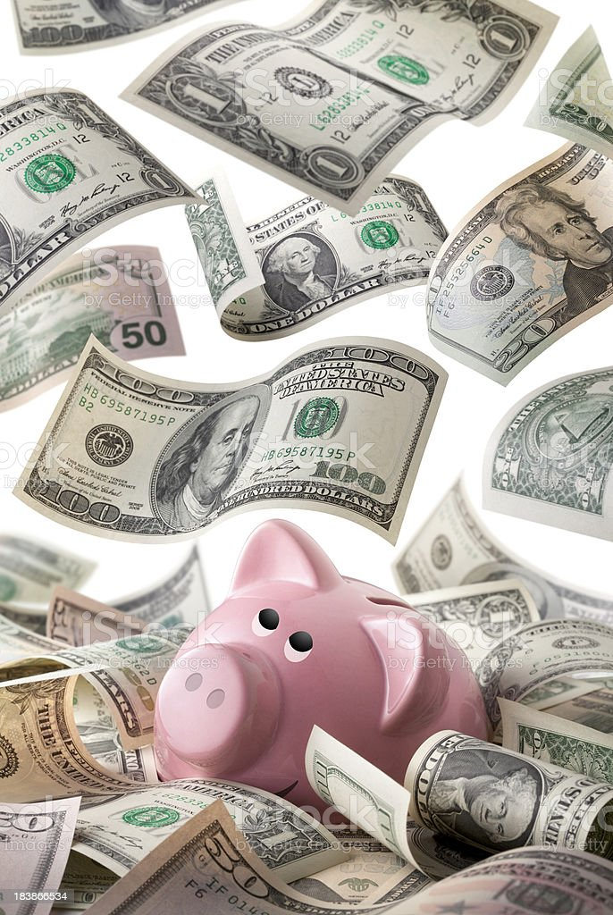 Piggy bank with dollars banknotes royalty-free stock photo