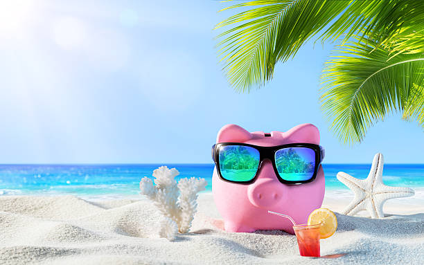 piggy bank with drink on the palm beach - piggy bank stock photos and pictures