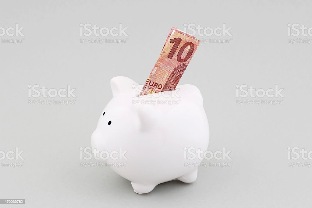 Piggy Bank With European Currency stock photo
