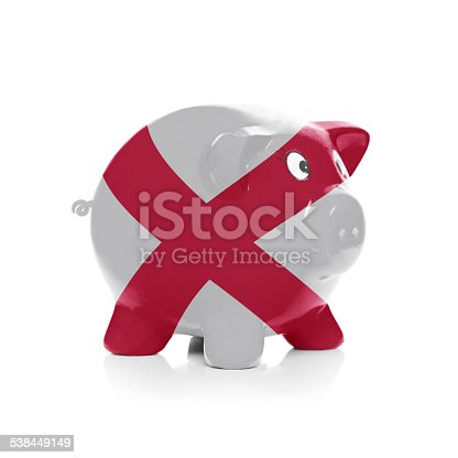 istock Piggy bank with flag coating over it - Alabama 538449149
