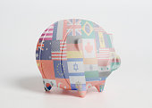 Piggy bank with Flags all countries of world