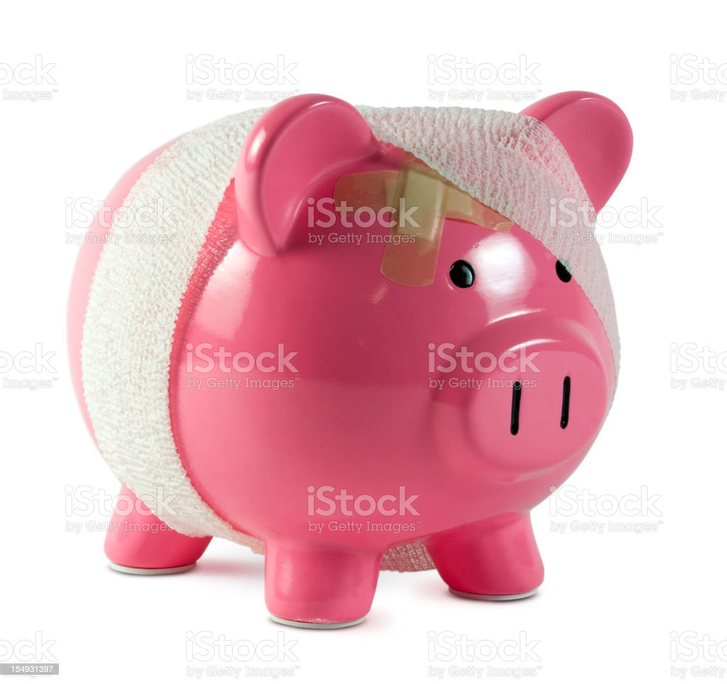 Piggy bank with gauze and band aids stock photo