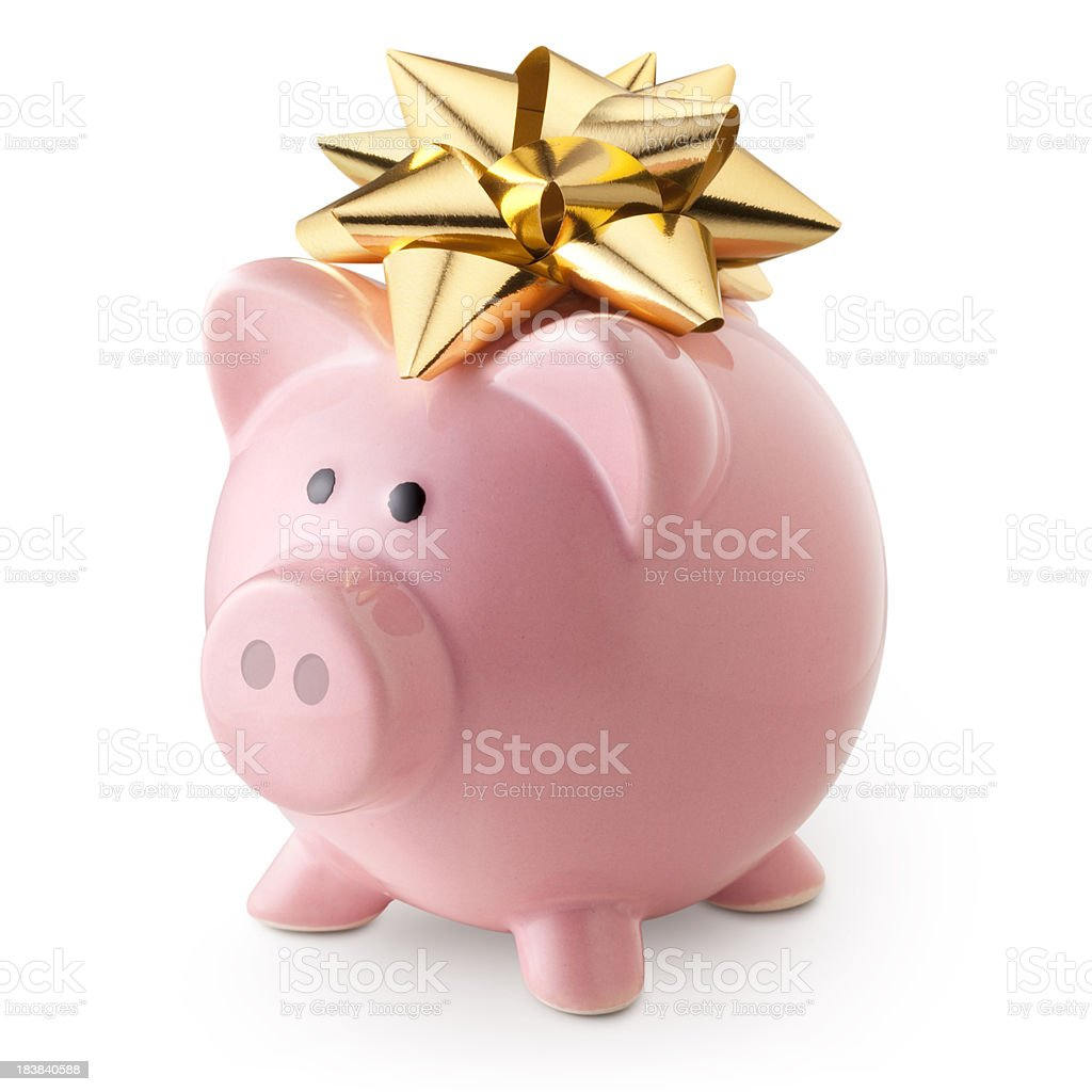 Piggy bank with golden bow royalty-free stock photo
