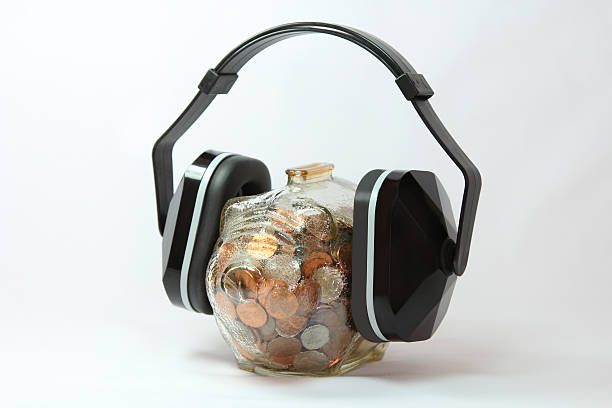 Piggy bank with headphones. stock photo