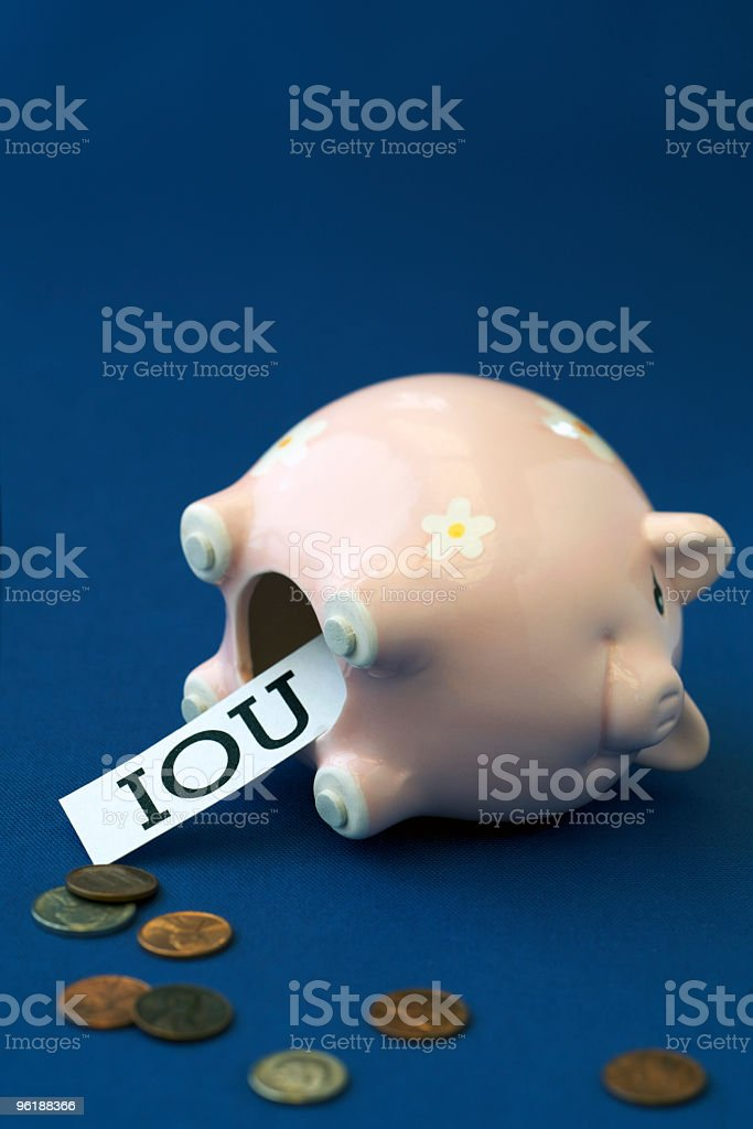 Piggy Bank with IOU, a Few Coins, Blue Background royalty-free stock photo