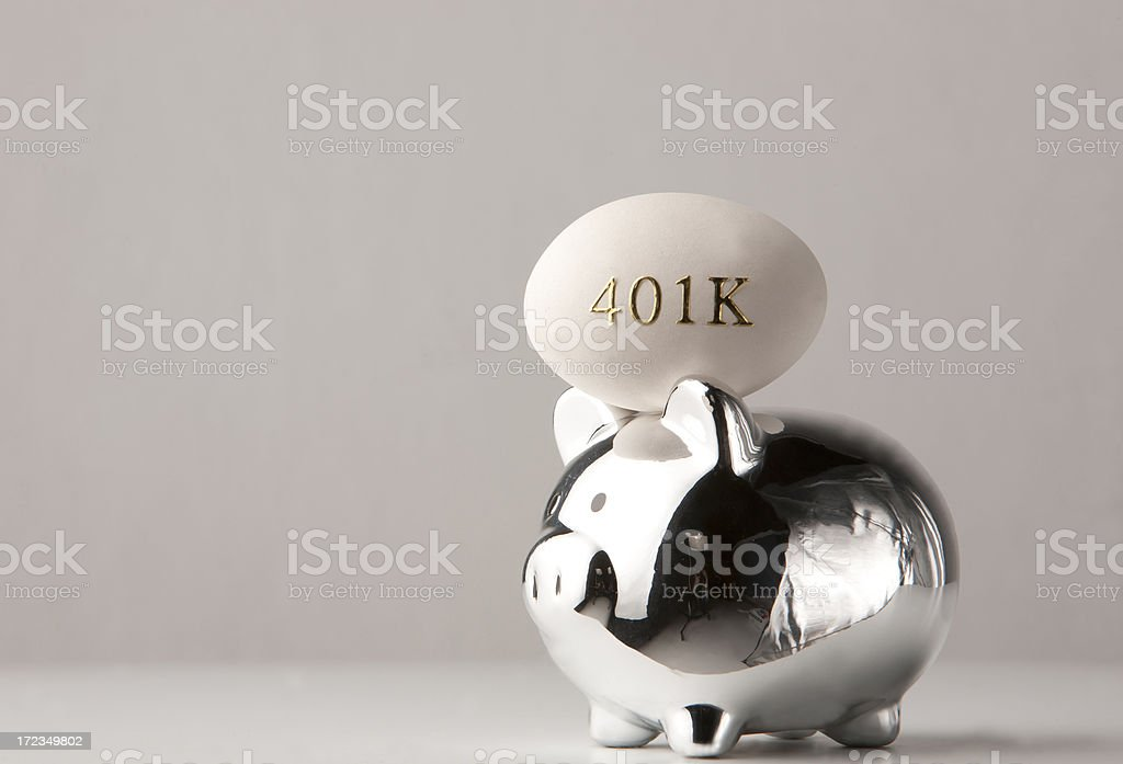 Piggy bank with nest egg for retirement royalty-free stock photo