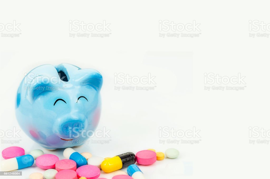 piggy bank with pill  isolated on white royalty-free stock photo