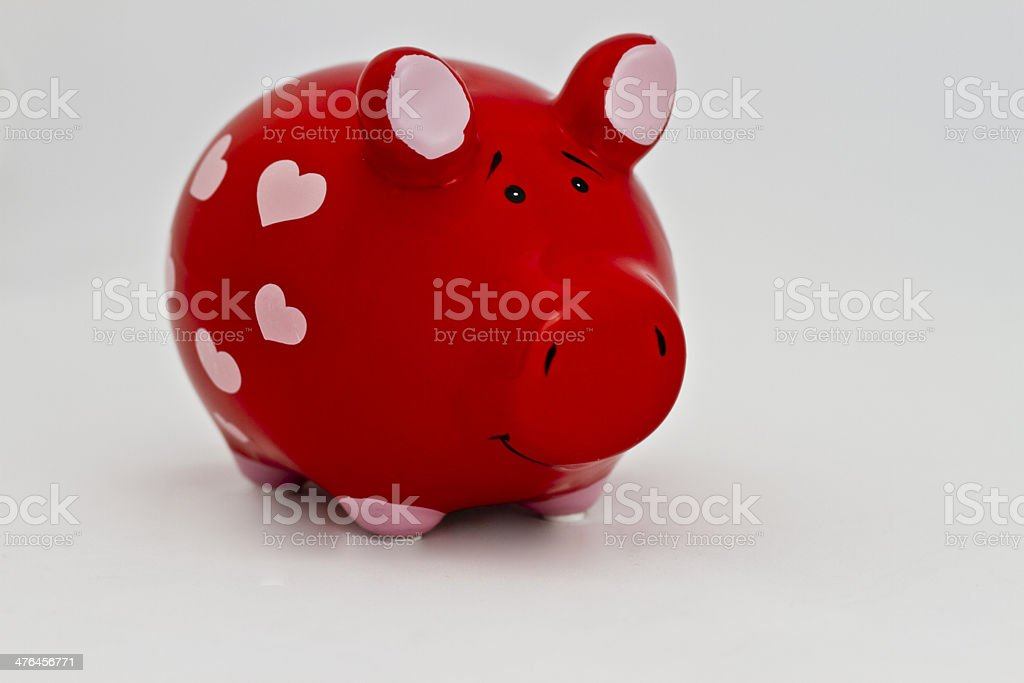 Piggy bank with pink hearts royalty-free stock photo