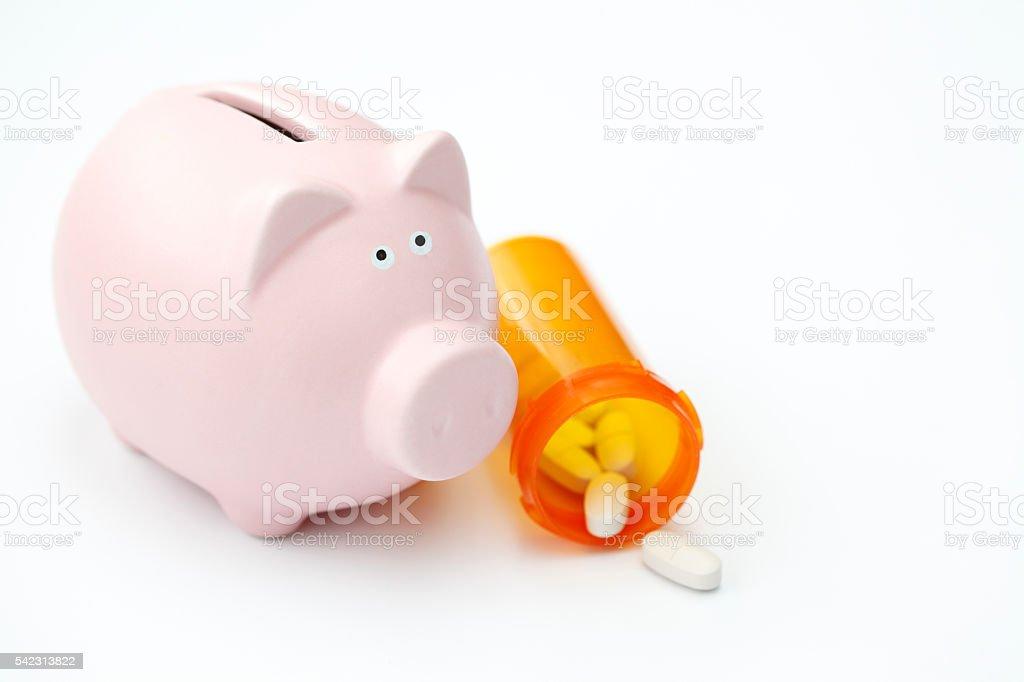 Piggy bank with prescription medicine stock photo