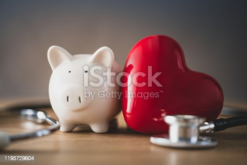 istock Piggy bank with red heart 1195729604