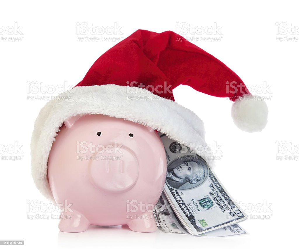 Piggy bank with Santa Claus hat and money stock photo