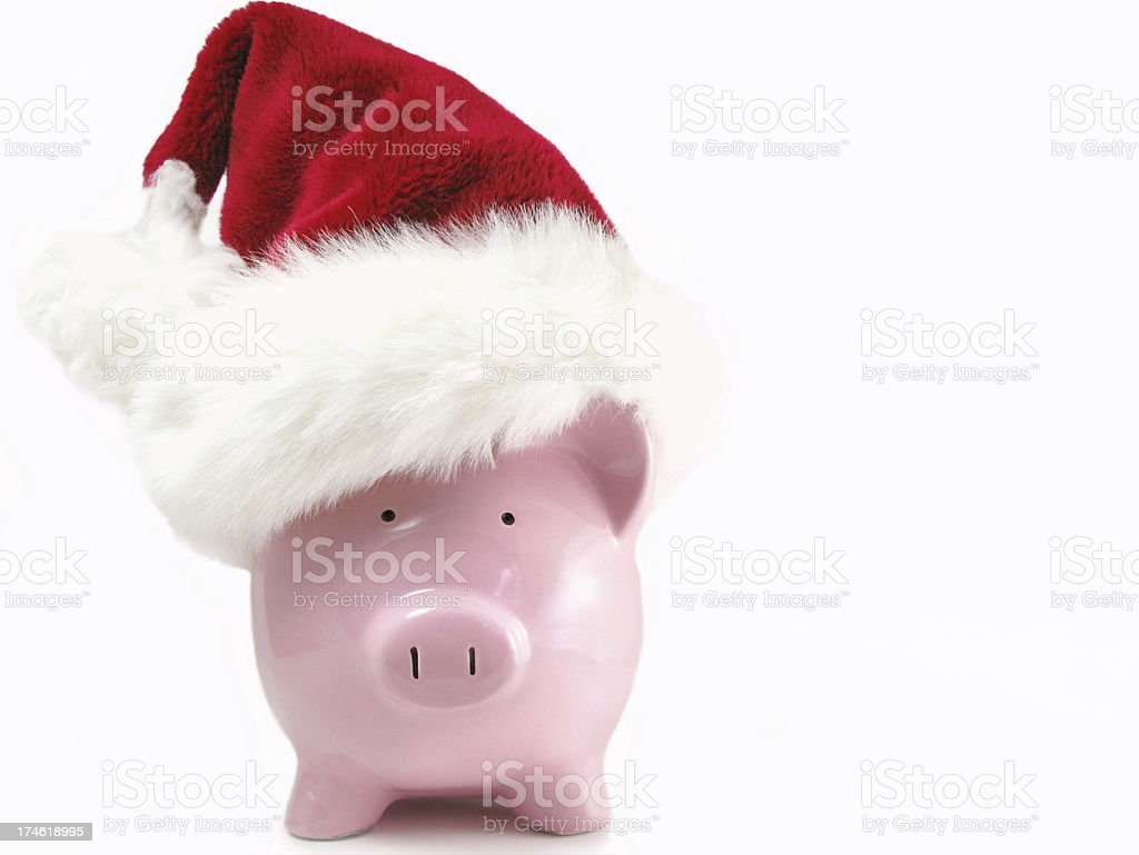 Piggy Bank With Santa Hat stock photo