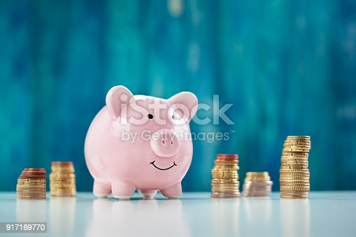 istock piggy bank with stacked coins 917169770