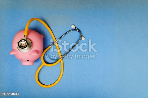 istock Piggy bank with stethoscope 867204006